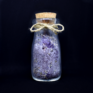 lavender dream salt in corked milk bottle on a black background